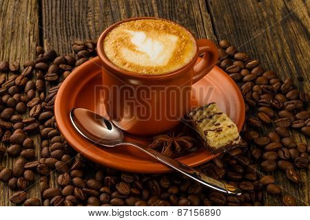 Cup Of Cappuccino, Milk-chocolate Wafer And Coffee Beans