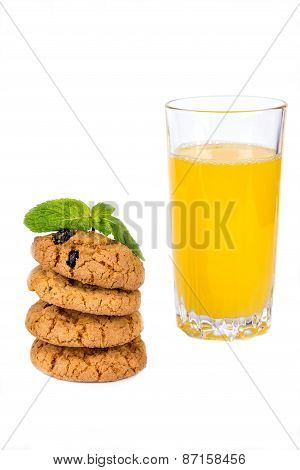 A Stack Of Cookies And Juice