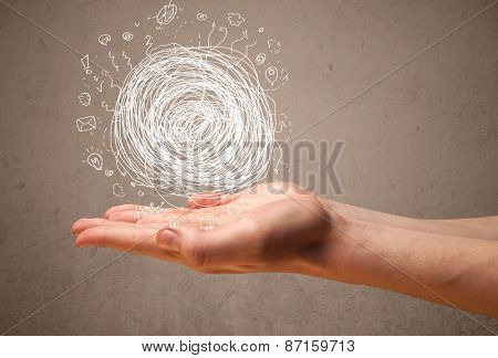 Businessman presenting chaos concept in her palm