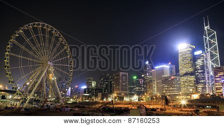Night View Of Buildings And Ferris Wheel On Oct 13, 2014 In Central, Hong Kong