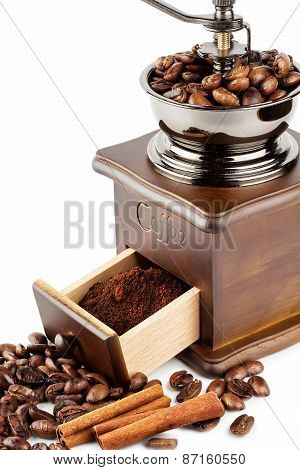 Coffee Grinder With Coffee Beans And Cinnamon