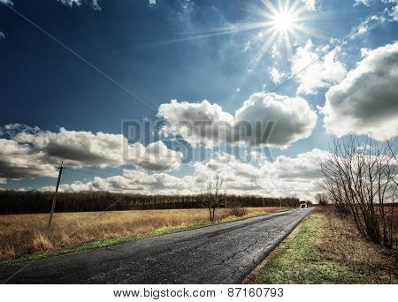 Paved Country Road With A Car Away