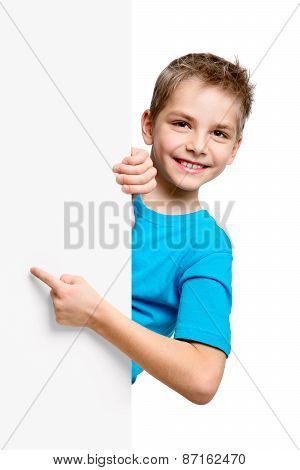 Portrait Of Happy Little Boy With White Blank
