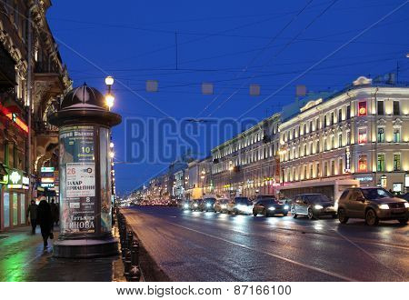 ST. PETERSBURG, RUSSIA - JANUARY 17, 2013: People and car traffic on the Nevsky Prospect in a winter morning. It is the main avenue of the city and one of the best-known streets in Russia