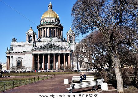 ST. PETERSBURG, RUSSIA - MARCH 5, 2015: People resting on the square in front of the St. Isaac's cathedral. It is the largest orthodox basilica and the fourth largest cathedral in the world