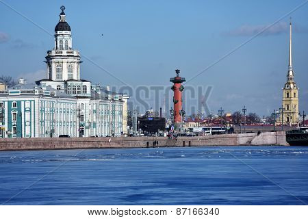 ST. PETERSBURG, RUSSIA - MARCH 5, 2015: Kunstkamera, Rostral column, and the Peter and Paul cathedral. The cathedral is the oldest landmark of the city, the Kunstkamera was completed in 1727