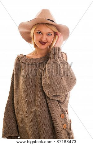 Girl In A Sweater And Cowboy Hat Smiling On A White Background