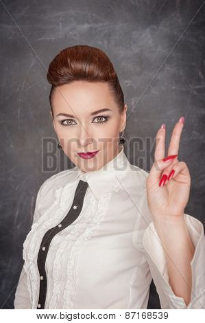Beautiful Fashion Woman Showing Victory Sign
