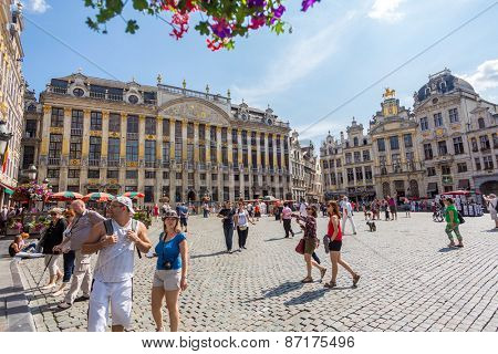 BRUSSELS, BELGIUM - AUGUST 5, 2014: Grand-Place (Grote Markt) is the central square of Brussels. Many tourists visit the most memorable landmark in Brussels.