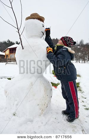 Cute Kid And Snowman