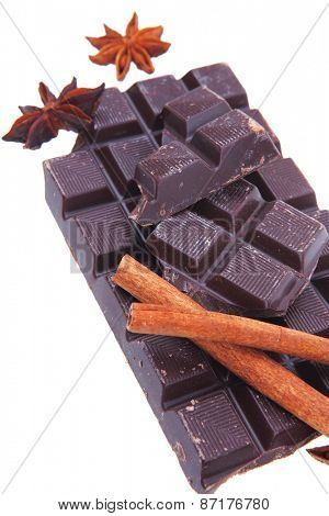 bar of dark chocolate isolated on white background