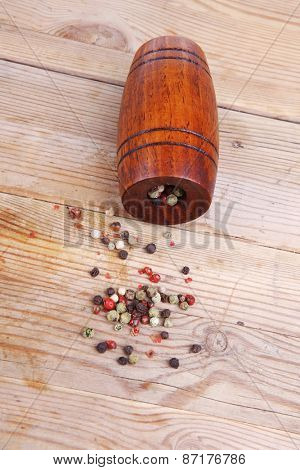 dry pepper with castor on wood