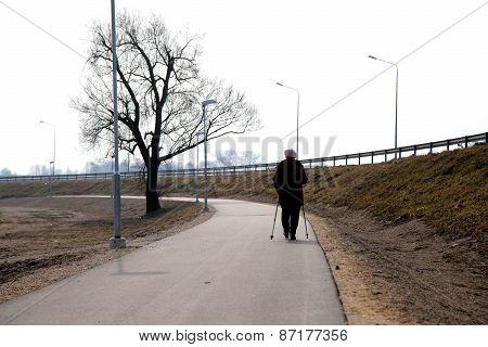Old Woman Making Nordic Walk