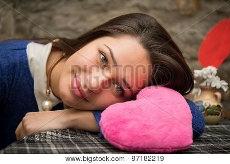 Beautiful Girl Lying With Pink Plush Heart