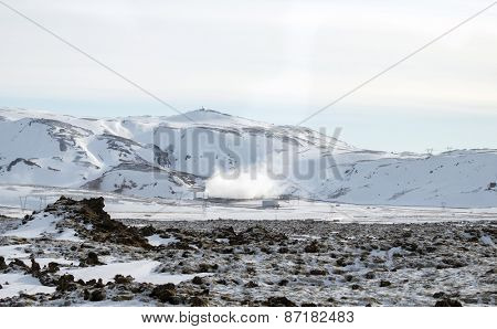 ICELAND - MARCH 24, 2015: Iceland electricity generation plants releases steam as a by-product. It uses geothermal energy from the earth and this an environmental friendly source of energy supply.
