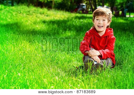 Cute 7 years old boy having fun outdoor. Summer day.