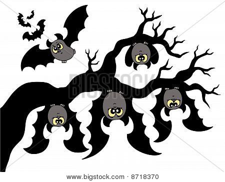 Cartoon bats hanging on branch