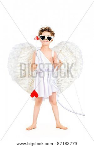 Lovely emotional little boy in a costume of angel. Cupid with a bow and arrows of love. Valentine's day. Isolated over white.