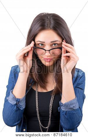 Beautiful Girl Looks Over Glasses
