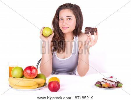 Girl Chooses Between An Apple And A Cake