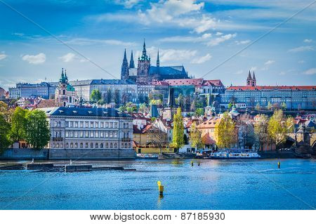 View of Gradchany (Prague Castle) and St. Vitus Cathedral in daytime over Vltava river