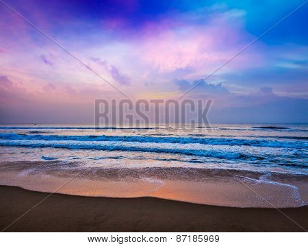 Peaceful ocean sunrise on beach