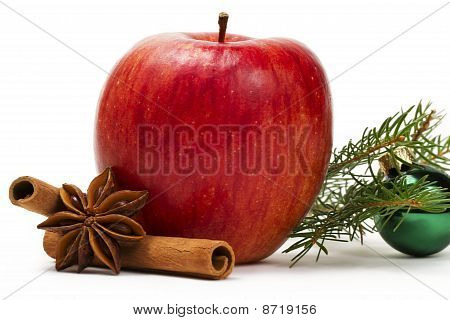 apple anise cinnamon green christmas ball and a branch