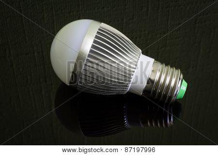 Close up Led Lamp on the black reflecting surface.