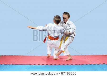 Girl with yellow belt makes slicing down under leg