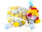 stock photo of pastel colors  - Artificial easter eggs in pastel colors and a colorful chicken over white - JPG