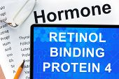 picture of hormones  - Papers with hormones list and tablet  with words  retinol binding protein 4  - JPG