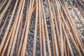 image of reinforcing  - Macro steel rods or bars used to reinforce concrete