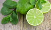 picture of mints  - Juicy ripe limes and mint on wooden table - JPG