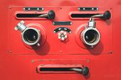 image of fire truck  - Close up red Fire truck hose connectors - JPG