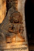 foto of guardian  - Guardian spirit on the walls of an ancient stupa at In Dein Inle Lake Myanmar  - JPG