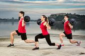 foto of pick up  - group of young people picking up barbell weight - JPG