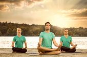 pic of serenity  - Group of serene people meditating in nature - JPG