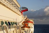 image of cruise ship caribbean  - First sunlight hits the side of a cruise liner in Caribbean - JPG