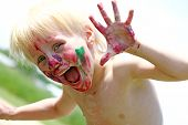 Постер, плакат: Happy Young Child With Messy Painted Face