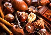 stock photo of white-milk  - Chocolates background - JPG