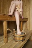image of sauna woman  - Beautiful woman in sauna bath accessories - JPG