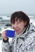pic of have sweet dreams  - woman is drinking hot tea on the sea shore - JPG