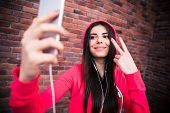 image of sportive  - Happy beautiful woman making selfie photo on smartphone - JPG