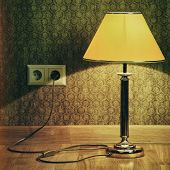 foto of plinth  - Turned On Old Lamp Near The Wall - JPG