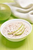 foto of porridge  - Oatmeal porridge with apple slices and cinnamon in white bowl - JPG