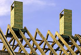 picture of rafters  - Wooden rafters on top of new house - JPG