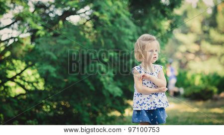 girl playing in a city park