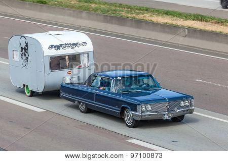 Classic American Car With A Caravan