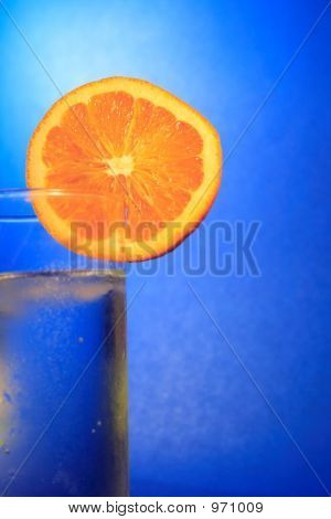 cool water with a slice of orange