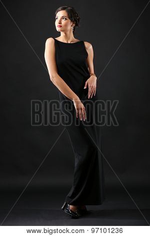 Retro style photo of young woman on dark background